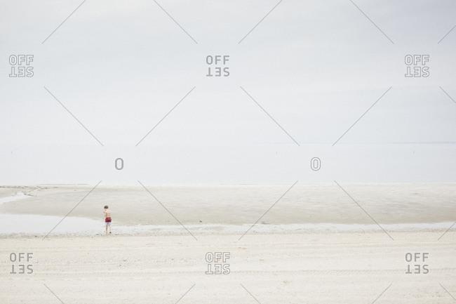 Child enjoying the beach at Greenwich Beach, USA