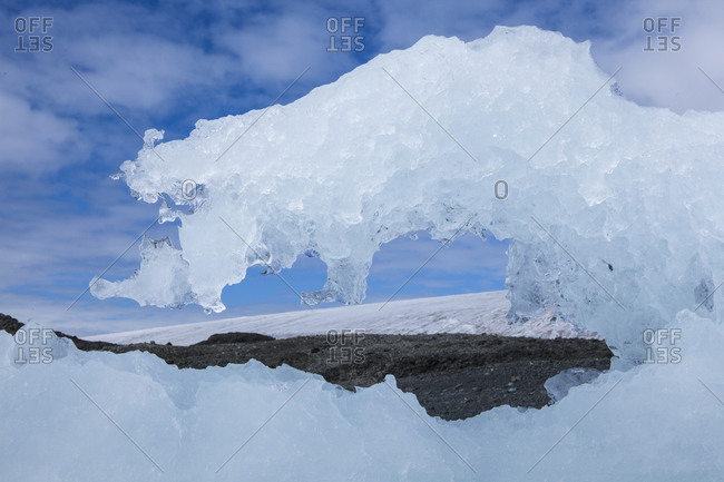 Landscape with a melting iceberg in the foreground in Antarctica