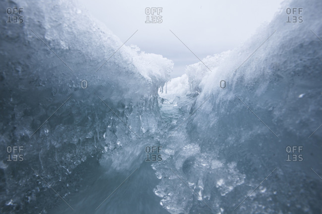 Melting water flowing in a shallow crevasse on the Buenos Aires glacier in Antarctica