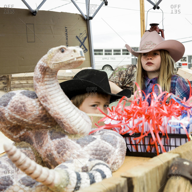 New Mexico, USA - May 11, 2013: Children wearing cowboy hats at a parade in the small town of Truth or Consequences, New Mexico, USA