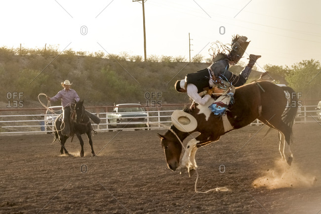 New Mexico, USA - May 11, 2013: Saddle bronc riding at a rodeo in Truth or Consequences, New Mexico, USA
