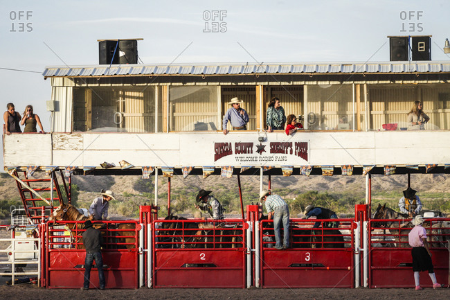 New Mexico, USA - May 11, 2013: Bronc riders wait for the chute to open in Truth or Consequences, New Mexico, USA