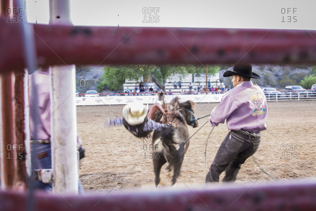 New Mexico, USA - May 11, 2013: Young boy gets bucked off a horse in Truth or Consequences, New Mexico, USA