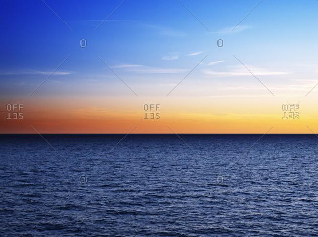 Sunset above sea