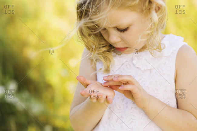 Girl looking at insect