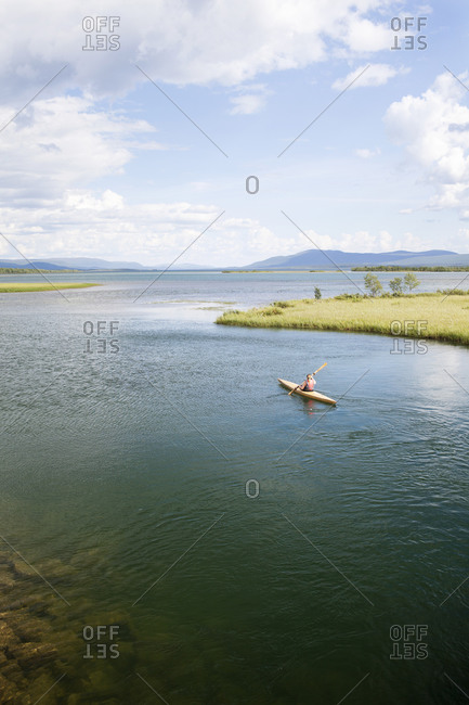 Person kayaking, Sweden - Offset Collection