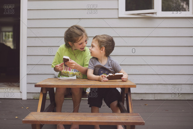 Shot of two kids eating ice cream sandwiches