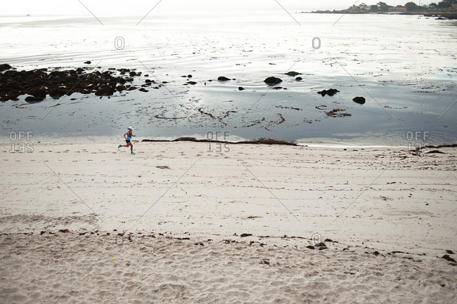 View of woman running on beach