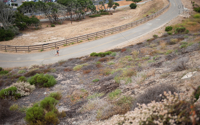 High angle view of female jogger on path