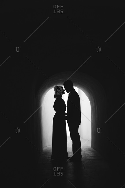 Couple nuzzling in tunnel