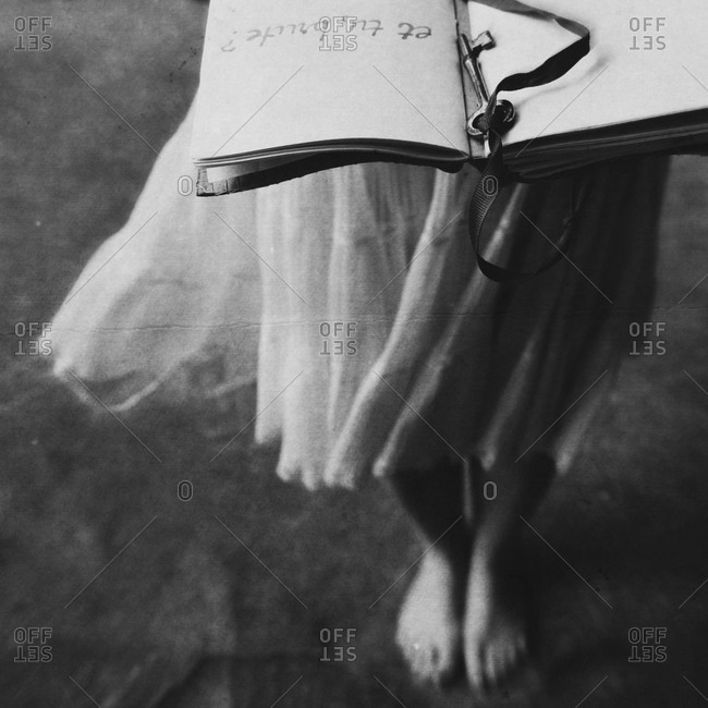 Close up of woman holding a book