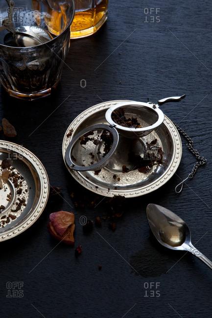 Steel tea ball infuser on a saucer