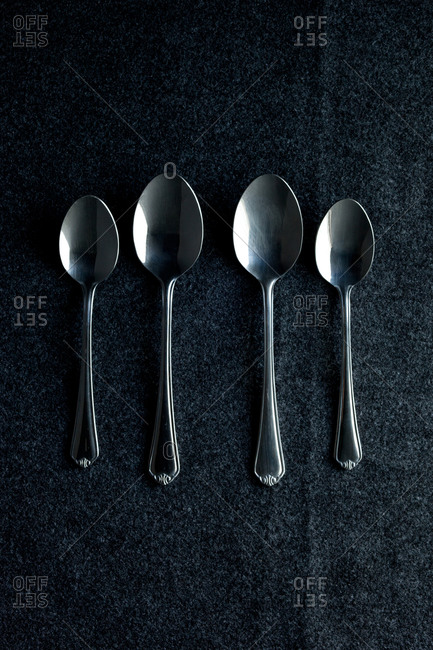 Four spoons in a row