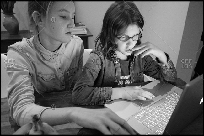 Two kids watching a laptop