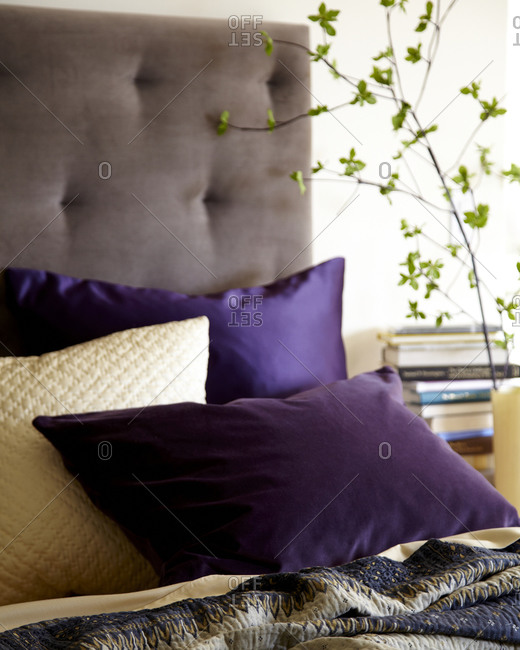 Purple pillows on a bed