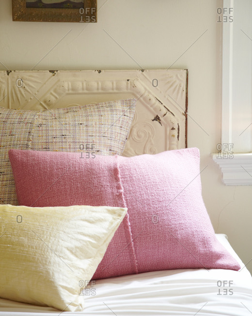 Close up of pillows on a bed
