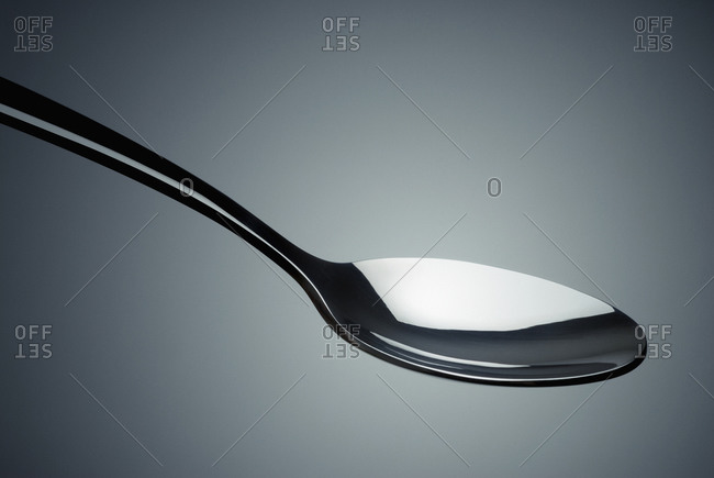 Close-up of a spoon in mid-air