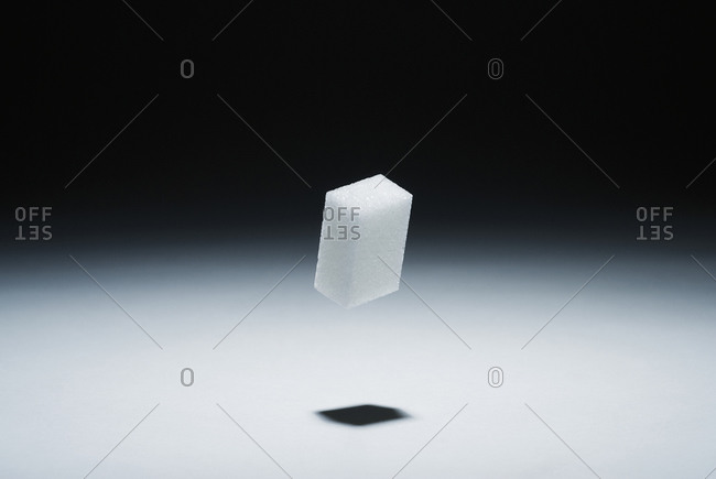 A cube of sugar in mid-air