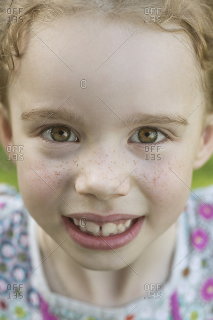 Close-up portrait of cute girl smiling