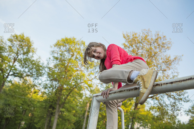 Portrait of girl climbing at playground