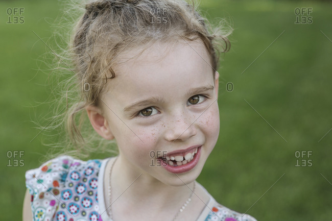 Portrait of cute girl smiling outdoors