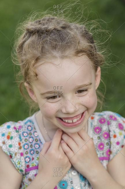 Cute girl smiling in park