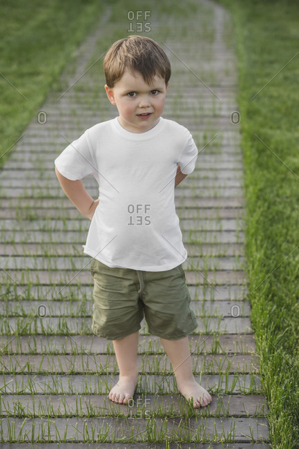 Full length portrait of cute boy standing in park