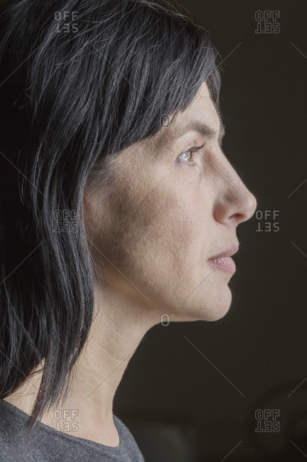 Close-up profile of woman looking away