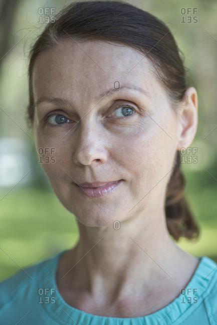 Close-up of thoughtful mature woman at park