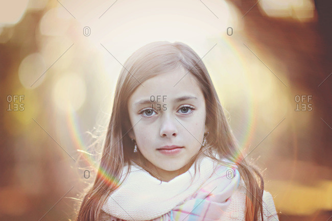 Portrait of girl in scarf with light halo effect