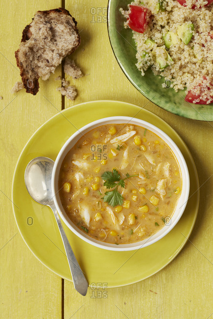 Top view of chicken and sweet corn soup with quinoa salad