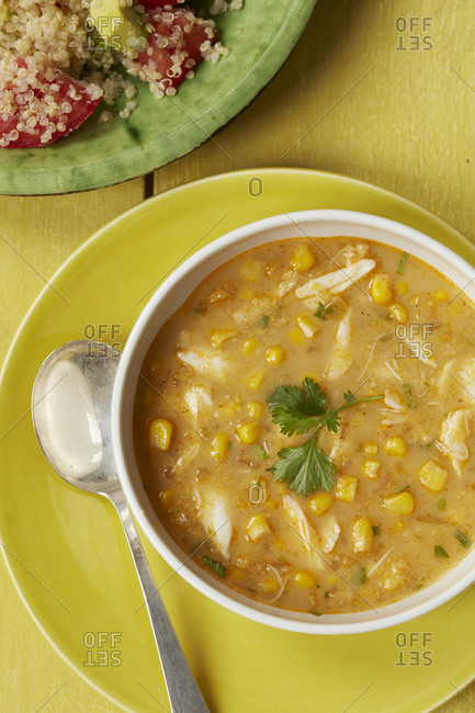 Close up of chicken and sweet corn soup with quinoa salad