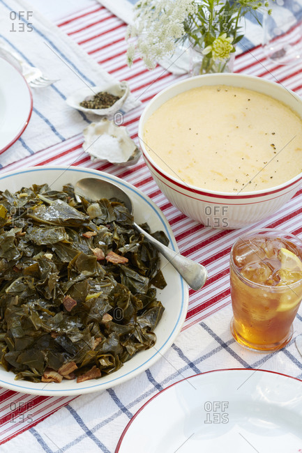Sauteed collard greens with bowl of grits