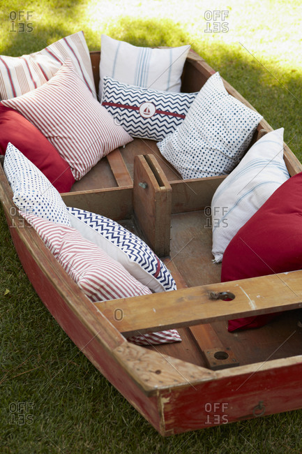 Old boat decorated with pillows