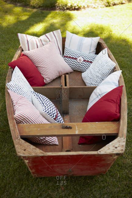 Boat with colorful cushions in a garden