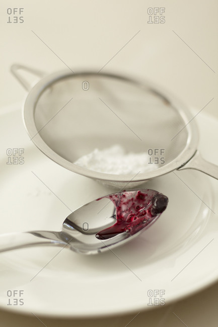 Spoon and a sieve on a plate