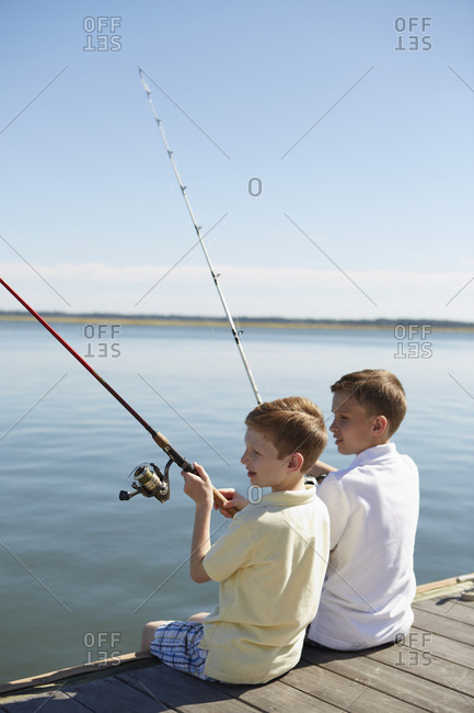 Boys fishing on a jetty