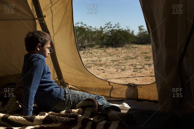 Boy sitting in a Teepee