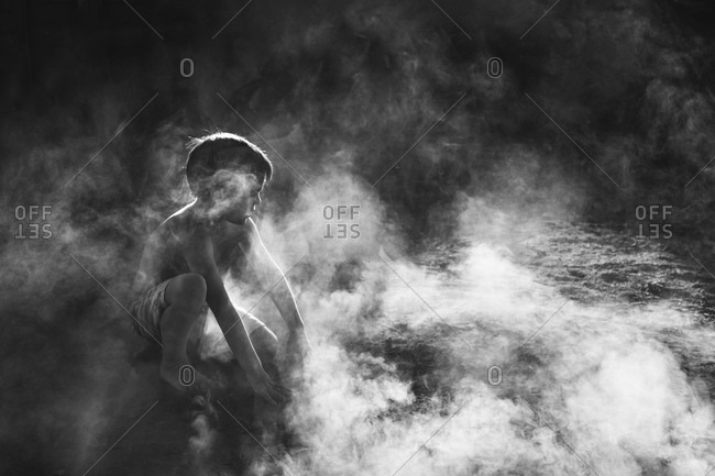 Boy playing in the dust