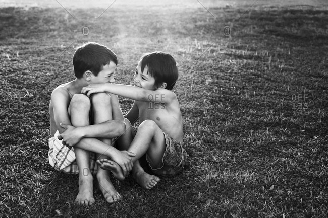 Children sitting in the grass together