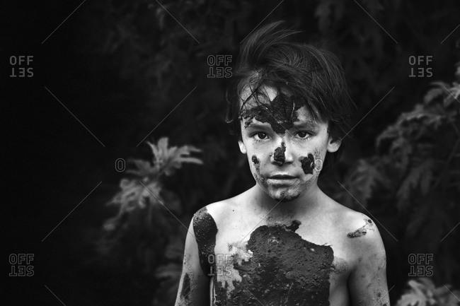 Portrait of a boy soiled by mud