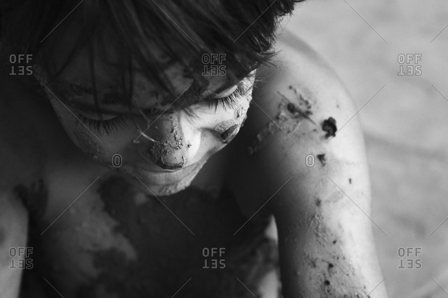 Overhead view of a boy soiled by mud