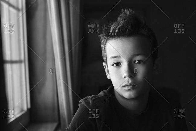 Portrait of a boy looks like fatigued