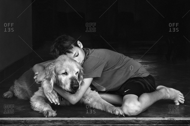 Kid hugging senior Golden Retriever
