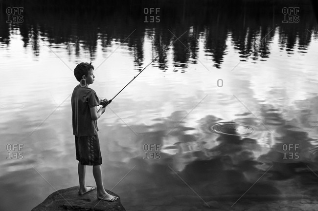 Boy standing with fishing rod