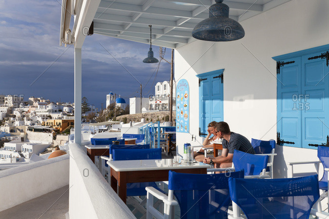 Santorini, Greece - May 19, 2011: Couple sit in a taverna
