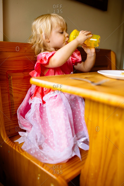 Little girl drinking from sippy cup