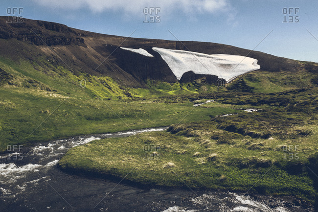 Snowy landscape and stream, Iceland