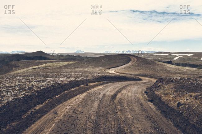 Dirt track in rolling landscape, Iceland