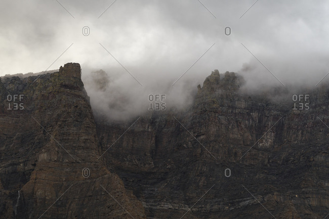 Low lying clouds envelop a mountain